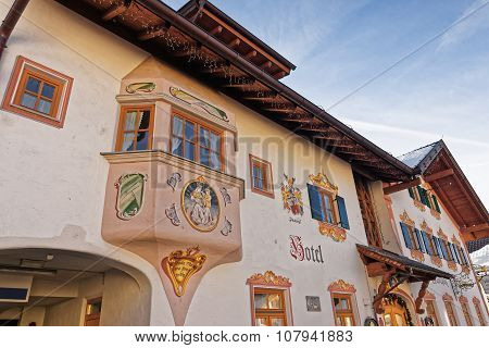 GARMISCH-PARTENKIRCHEN GERMANY - JANUARY 06 2015: Closeup view of the facade of a hotel in Garmisch-Partenkirchen beautifully adorned with religious and historic painted scenes
