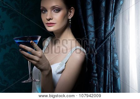 Portrait of beautiful woman with martini glass