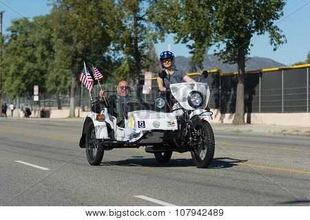 American Veteran.on The Motocycle Holding American Flag