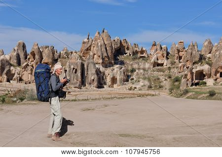 Rock Formations Of Cappadocia And Photographer
