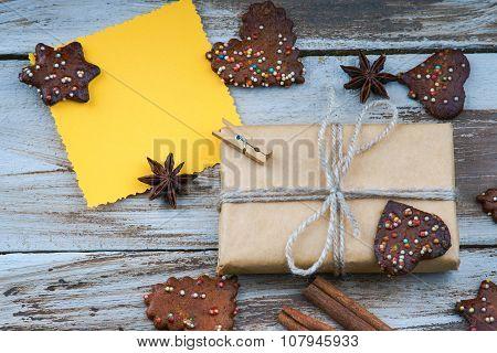 Christmas gift box, greeting card, cookies and cinnamon