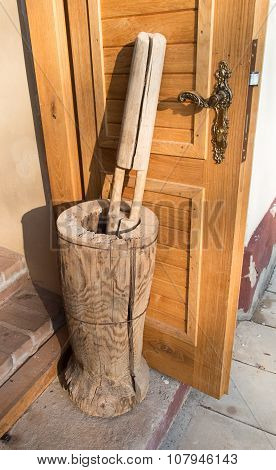 Old Wooden Mortar Standing At The Door Of The Bakery,