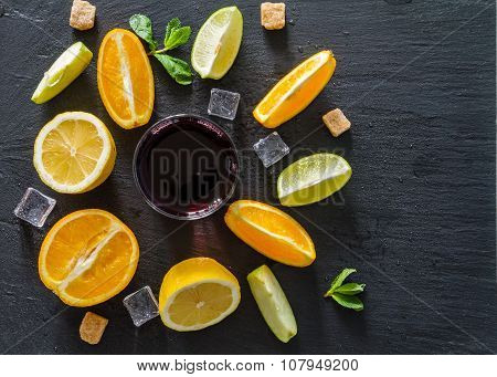 Sangria and ingredients, dark stone background