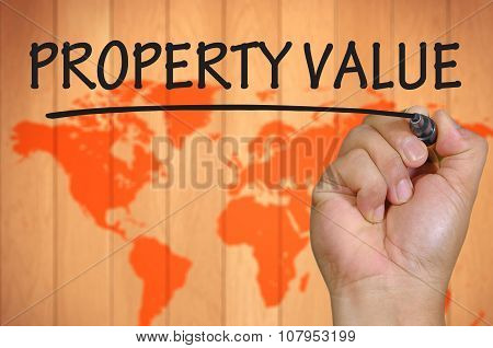 Hand Writing Property Value Over Blur World Background
