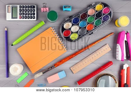 Bright stationery objects on wooden table close up