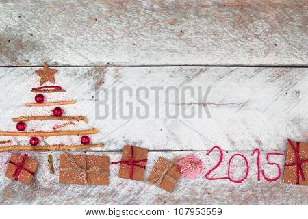 Christmas tree made of cardboard gift on wood background
