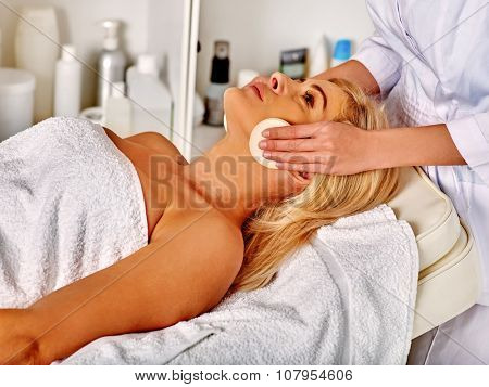 Woman middle-aged in spa salon recieve beauty procedure .