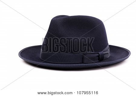A Classic Low Crown Fedora Hat In A Dark Blue Color. Isolated On White Background.