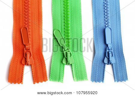 Colourful collection of zippers isolated on white, close-up
