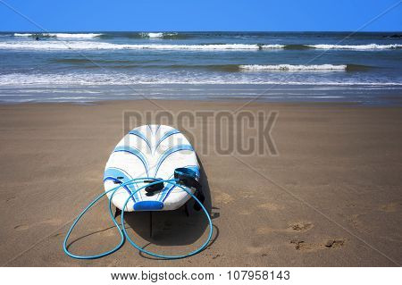 Surfboard On Sand At Beach