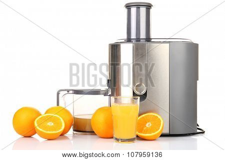 Stainless juice extractor with oranges isolated on white background