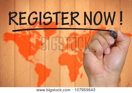 Hand Writing Register Now Over Blur World Background