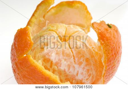 Peeled Fruit With Orange Peel Isolated On White