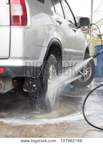 Car Washing. Cleaning Wheels Using High Pressure Water..