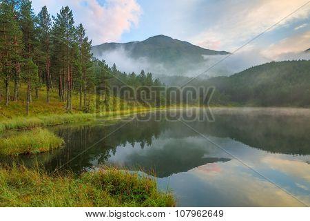 Foggy day at mountain lake