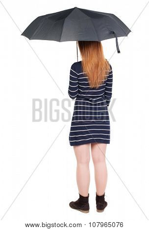 young woman under an umbrella. Rear view people collection.  backside view of person.  Isolated over white background. Girl in a short dress hiding under an umbrella