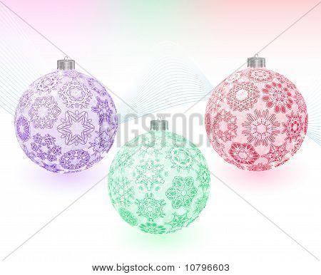 Bolas de la Navidad con la textura de los copos de nieve