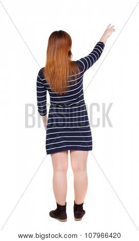 Back view of  pointing woman. beautiful girl. Rear view people collection.  backside view of person.  Isolated over white background. Girl shows two fingers up to the left hand