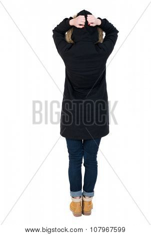 Back view of shocked woman in parka. upset young girl. Rear view people collection.  backside view of person.  Isolated over white background.