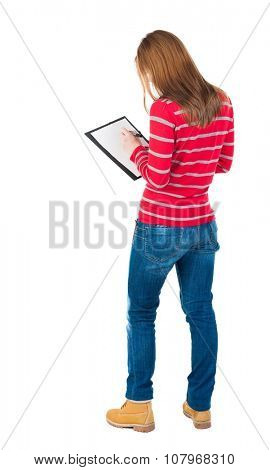back view of writing beautiful woman. Young girl in dress. Rear view people collection.  backside view of person. Isolated over white background. Girl in red sweater writing on the tablet.