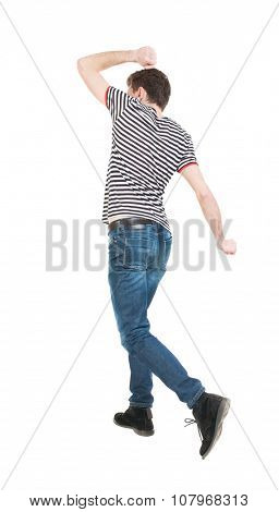 Back view of running man in brown shirt. Walking guy in motion. Rear view people collection. Backside view of person. Isolated over white background. Frenchman ran waving his arms.