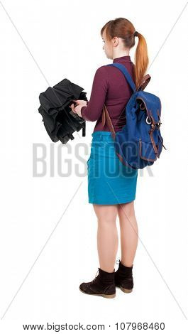 young woman with a backpack  under an umbrella. Rear view people collection.  backside view of person.  Isolated over white background.