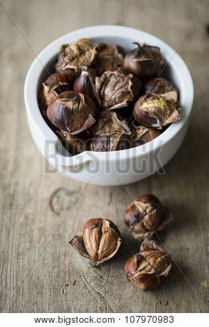 Chestnuts In A Small White Pot