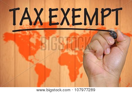 Hand Writing Tax Exempt Over Blur World Background