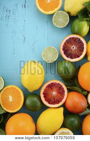 Citrus Fruit On Blue Wood Table.