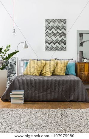 Bed With Decorative Yellow Pillows