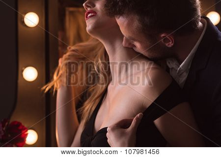 Man Kissing Beautiful Woman's Neck