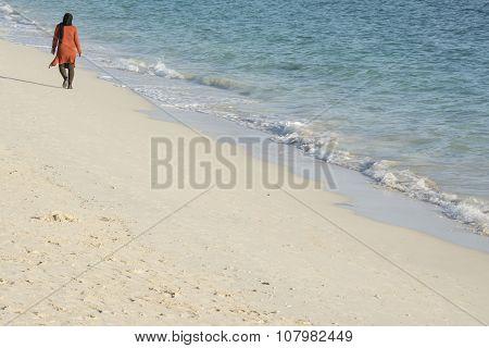 Muslim Woman Walking On Beach