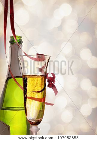 Glass And Bottle Of Sparkling White Wine And Ribbons Hanging