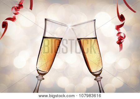 Two Glasses Of Sparkling White Wine Toasting Bokeh Background