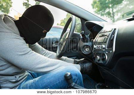 Thief With Mask Sitting In A Car