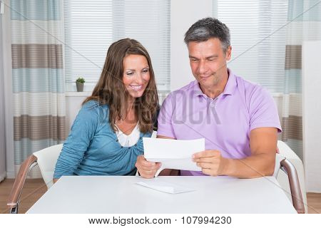 Couple Reading Letter Together