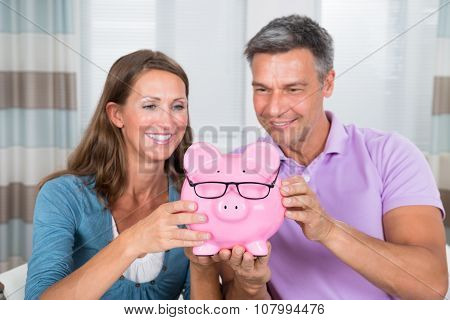Couple Holding Piggybank