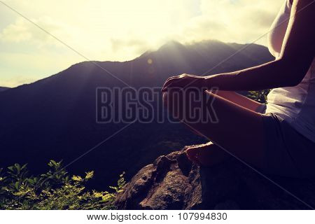 young yoga woman on sunrise mountian peak