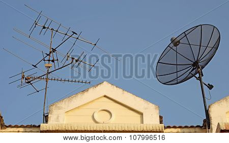 Satellite Dish And Television Antenna On Roof