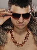 stock photo of gangster necklace  - Picture of a stylish man in sunglasses - JPG