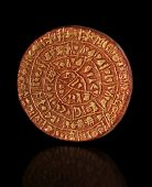 stock photo of minos  - Copy of Phaistos Disc from Crete on a black background - JPG