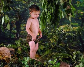 pic of tarzan  - A happy preschooler playing Tarzan in a jungle - JPG