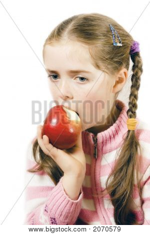 A Thoughtfull Girl Eating An Apple