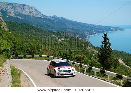 YALTA, UKRAINE - JUNE 04: Karl Kruuda driving his Skoda Fabia Super 2000 during the IRC event Yalta Rally 2011 in Yalta, Ukraine on Jun 04, 2011