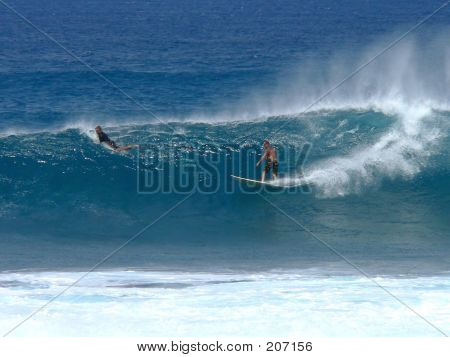 Surfer Takes A Right Break On A Good Wave