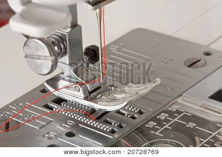 Thread In Needle Of Sewing Machine Closeup