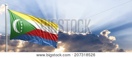 Comoros waving flag on blue sky. 3d illustration
