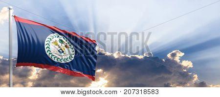 Belize waving flag on blue sky. 3d illustration