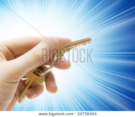 human hand with keys isolated on background