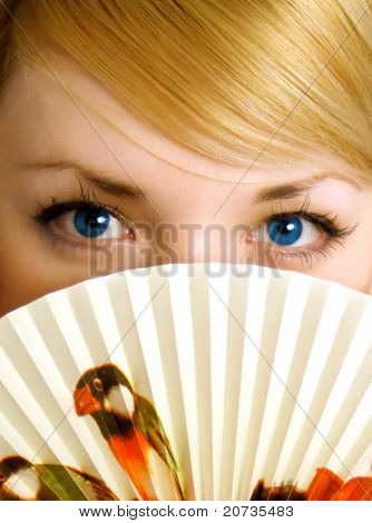 beauty young girl with fan